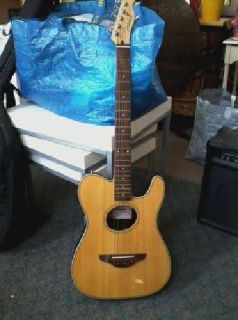 $200 Brand new Fender Telecoustic with case and Crate amp