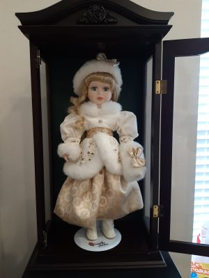 "Brass Key 17"" porcelain doll and display case"
