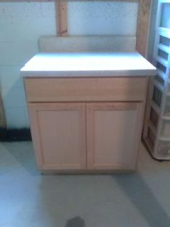 2 unfinished floor cabinets