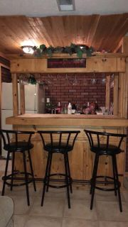 Bar with glasses and chairs