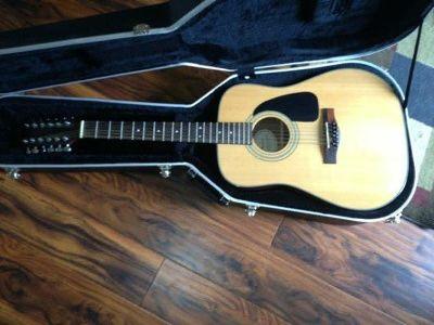 $90 Fender 12 string guitar and case with neck slider