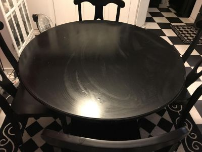 Black round dining table and chairs