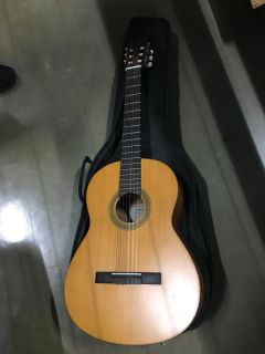 Yamaha Acoustic Guitar with soft case