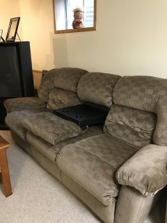 sofas with two recliners and a coffee stand in the middle
