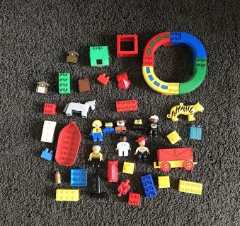 25 LEGO Pieces, 8 LEGO People, 4 piece connecting round track (you can take apart), Wagon, Boat & 2 Animals
