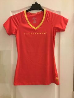 Nike ladies Livestrong orange and yellow stripped dri fit top. Size small