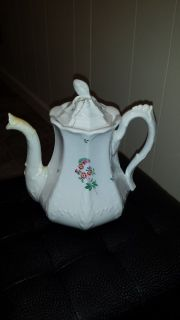Antique tea pitcher