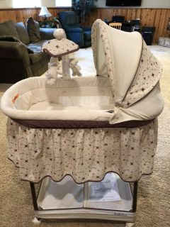 Bassinet in perfect condition vibrates, sways, plays music, rotating mobile, and lights