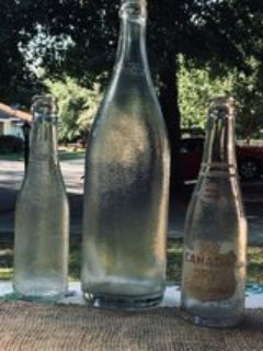 lot of three clear vintage textured Canada Dry glass bottles