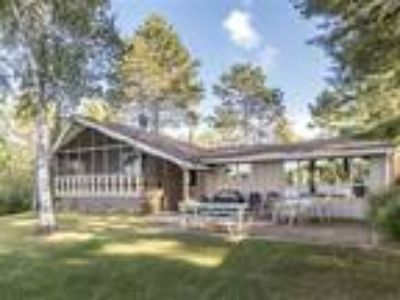 Adorable Tomahawk Lake Home on Pancake Level Lot!