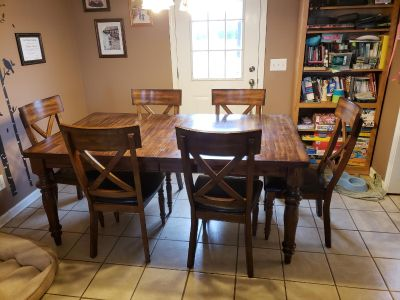Large dining room table with chairs
