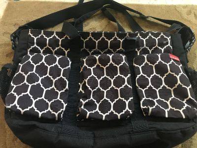 Skip hop diaper bag. I paid $70 for it. Good used condition.All zippers are working but belts needs quick fixing. Not smoking home. Needs wi