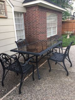 Awesome wrought iron patio set. Texas chairs are extremely solid and heavy. Quality. Each chair retails for $150.
