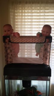 To cute twin dollies, 1 boy 1 girl. Comes with crib.