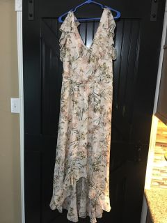 Very pretty Easter high low dress. Size 14