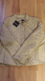 New, never worn. Womens cream colored jacket. Size is Petite Large. Brand is Baccini.