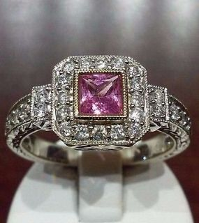 18kt gold engagement ring with 0.51 ct princess cut pink sapphire