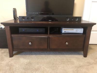 48 L x 21 D x 21 H dark wood TV stand. Drawers slide easily, great condition! Used in a spare room.