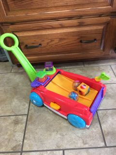 """FISHER PRICE """"ROLLER BLOCKS ROCKIN' WAGON"""" - LIKE NEW - CHECK PICS ABOVE BATTERIES INCLUDEDWAGON 17""""-HANDLE DOWN 32"""" READ BELOW"""