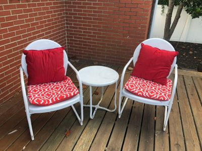 Two metal white chairs with table and cushions . Vintage and great condition.