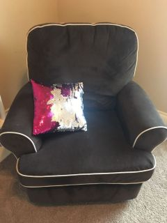 Swivel, rocking, reclining chair with ottoman