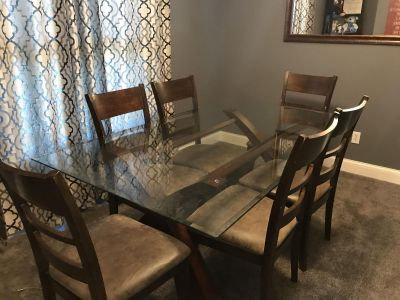 Large rectangle glass top table with 6 chairs