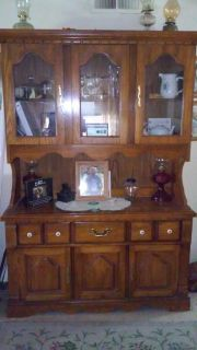 Very nice wooden, matching dining room set and china hutch.