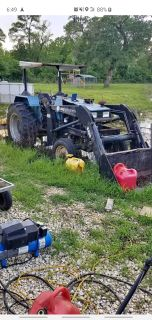 Long 480 tractor with front wnd loader