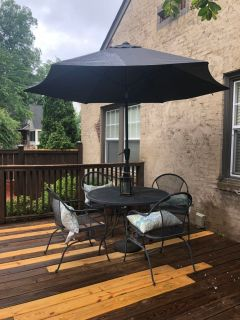 Iron table and chairs with umbrella