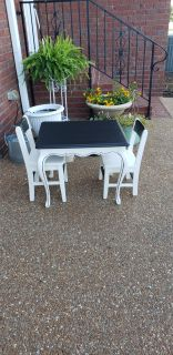 Childs table and 2 chairs.