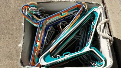 Large lot of plastic hangers - tote not included