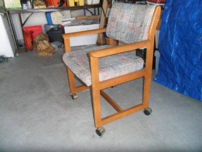 Two wooden chairs with cushion on wheels