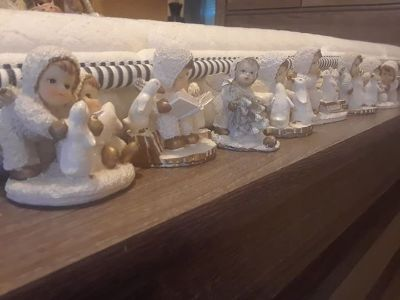 7pc Vintage ceramic world snow angel figurines