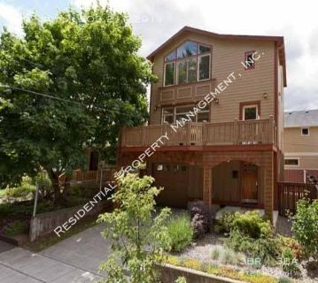 Contemporary Craftsman Home with views of Alberta Park!