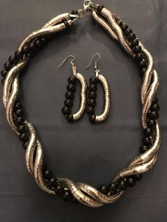 Black bead and silver necklace