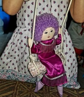 Russ Berrie Doll Lady on Swing Offered here is a charming Russ Berrie lady doll sitting on a swing