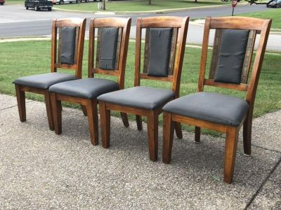 4 solid wood chairs.
