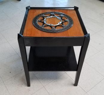 End table with Motorcycle brake in epoxy.