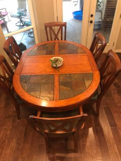 Solid wood table, 6 chairs with leather seats