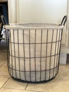 Farmhouse style metal basket with canvas liner and handles
