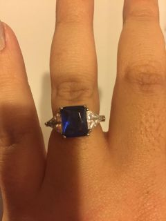 Created sapphire ring with white sapphire side stones
