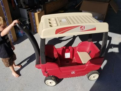Step 2 canopy wagon! Like brand new- just needs a bath (which I will do before pickup) top and poles remove. $30