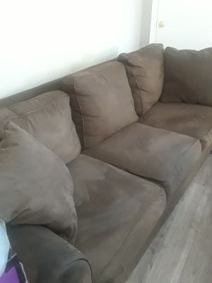 6ft sofa with matching chair and ottoman that has storage