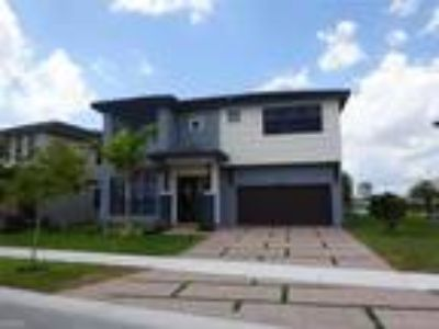Five BR Three BA In Miami Lakes FL 33018
