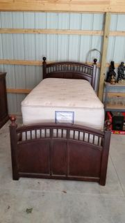 Twin bed with mattress and Armoire. Mattress can be low or high.