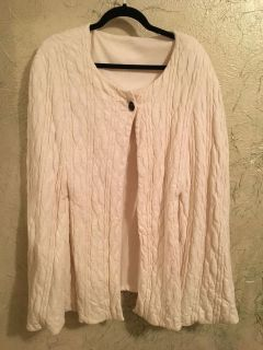 Cream quilted poncho with arm slits. Excellent condition, no stains, washable. Great for casual or dress wear
