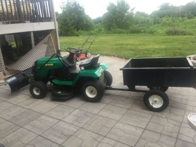 Tractor with snow plow small trailer