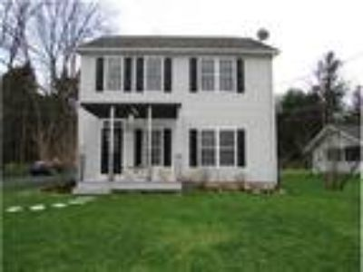 Cozy 2 Story Home Three BR and 2.5 BA with a unique floor plan with lots of