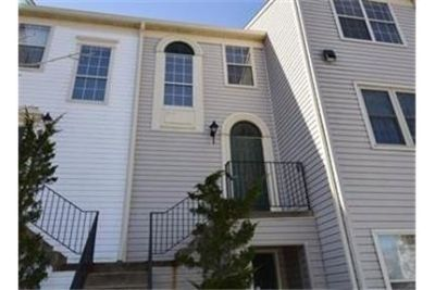 Beautifully updated condominium withbalcony facing wooded open space.