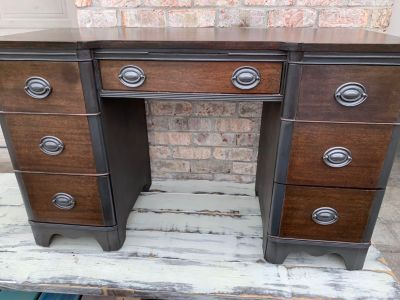 Refinished two-tone solid wood desk.